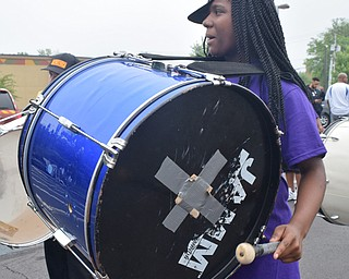 William D. Lewis The Vindicator Jahniya Carnathan plays bass drum with Time Keepers Drumline during 6-2-18 Unity Parade in Youngstown.