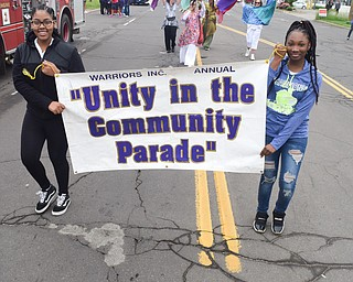 William D. Lewis The Vindicator   Mone' Reed, 17, left, and Azyah Rozenblad, 16, lead the Unity Parade on Market St in Youngsotwn 6-2-18. Both are from Youngstown.