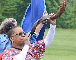 William D. Lewis The Vindicator  Debra Ingram of Youngstown sounds the shofar during Unity Parade 6-2-18. The shofar is a rams horn played like a bugle.