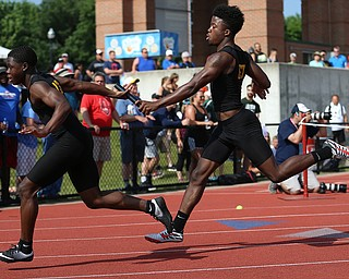COLUMBUS, OHIO - June 2, 2018, OHSAA Track & Field Championships at Jesse Owens Stadium, Ohio State University-  D3 4x200 Youngstown Valley Christian School's Jamynk Jackson passes the baton to his teammate Lohron Brown during YCVS's winning state title effort.  SPECIAL TO | VINDICATOR