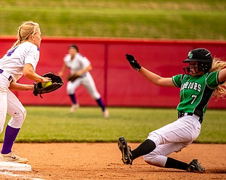 DIANNA OATRIDGE | THE VINDICATORÊ West Branch's Grace Heath slides into a force out by Keystone's Val Broschk at third base during the Division II State Championship in Akron on Saturday. Keystone won 3-2 in 12 innings.Ê.