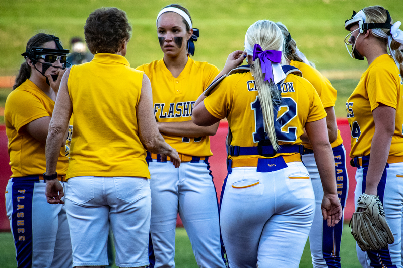 DIANNA OATRIDGE | THE VINDICATORÊ Champion coach Cheryl Weaver talks to her team on the mound after Cardington-Lincoln scored a run during the Division III State Championship in Akron on Saturday..