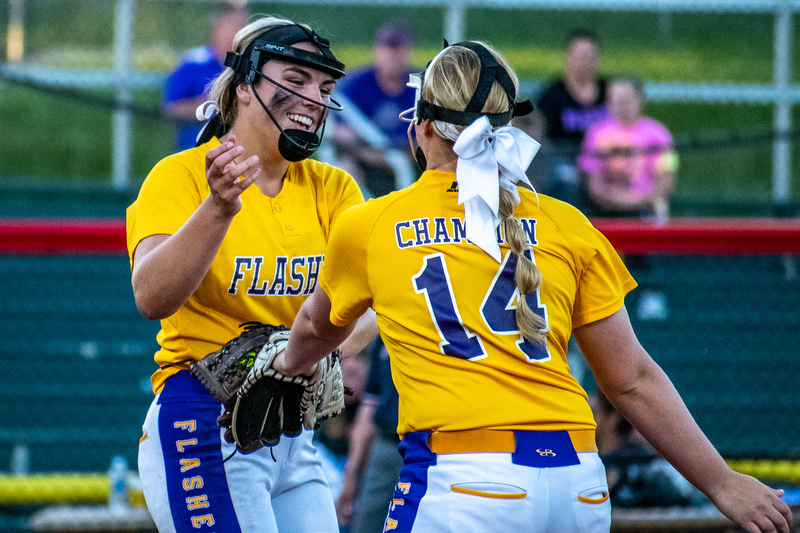 DIANNA OATRIDGE | THE VINDICATORÊ Champion's Sophie Howell (right) congratulates pitcher Allison Smith (left) after a strikeout during the Division III State Championship in Akron on Saturday.