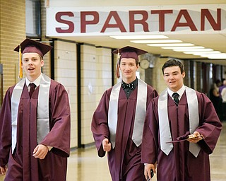 William D. Lewis The Vindicator   Boardman grads from left, Jacob Smotzer, David Giancola and Devin Whitaker walk through hall of BHS one last time before 6-3-18 commencement.