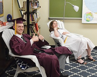 William D. Lewis The Vindicator Taking it easy before start of Boardman commencement at grads Sean Buck and Annaliisa(correct) Cordova.