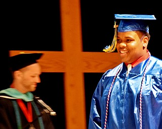 William D. Lewis The Vindicator    Valley Christian grad Randy Madison walks across the stage to recieve his diploma during 6-3-18 commencement at Highway Tabernacle.