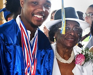William D. Lewis The Vindicator  Valley Chritian grad Terrance White sharea a moment with his grandmother Lenora White after 6-3-18 commencement at Highway Tabernacle. Terrance was a member of the 4x2 Valley Christian School relay team that took a first place at State track in Columbus this weekeand.
