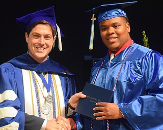 William D. Lewis The Vindicator  Valley Christian grad Randy MAdison gets his diploma from Dr. Joushua Reichard during 6-3-18 commencement.