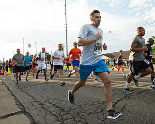 Scott R. Galvin | The Vindicator.Joseph Safarek of Canfield leaves the starting line for the beginning of his 5K run during the first inaugural Youngstown Marathon on Sunday, June 3, 2018.