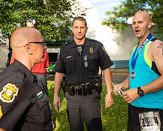Scott R. Galvin | The Vindicator.Jake Lape, right, talks with Boardman Police Sgts. Glenn Patton and Brian Habeger following his 5th place finish in the 5K run at the first inaugural Youngstown Marathon on Sunday, June 3, 2018.  Lape is also a police officer with Boardman Township.