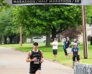 Scott R. Galvin | The Vindicator.Jon Hutnyan of Baltimore, Maryland, crosses the finish line first in the half marathon run during the first inaugural Youngstown Marathon on Sunday, June 3, 2018.