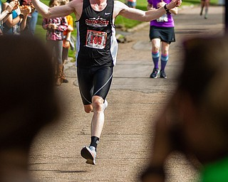 Scott R. Galvin   The Vindicator.Erik Reed of East Liverpool celebrates as he runs toward the finish line finishing first in the first inaugural Youngstown Marathon on Sunday, June 3, 2018.