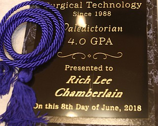 ROBERT K YOSAY  | THE VINDICATOR..Blue rope as Rich Lee Chamberlain Valedictorian received a plaque and rope for his accomplishment..Ford Family Recital Hall located in the DeYor Performing Arts Center. More than 60 full time students graduated from the three adult education programs offered at Choffin: 15 Dental Assisting students, 33 Practical Nursing students, and 18 Surgical Technology students..-30-