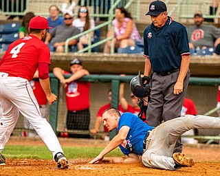 DIANNA OATRIDGE | THE VINDICATOR Springfield's Johnny Ritter, representing the Mahoning team, slides into home but is tagged out by Trumbull player, Sam Wells, from LaBrae during the All-Star Classic at Eastwood Field in Niles on Friday.