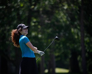Eileen McHale smiles after driving her ball during the Greatest Golfer junior qualifier on Thursday at Trumbull Country Club in Warren.