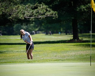 Gianna Myers hits her ball during the Greatest Golfer junior qualifier on Thursday at Trumbull Country Club in Warren.