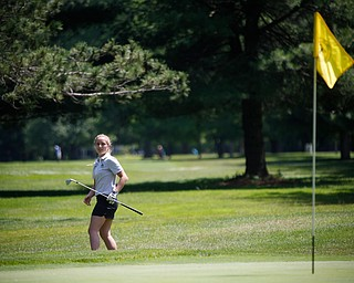 Gianna Myers reacts to her hit during the Greatest Golfer junior qualifier on Thursday at Trumbull Country Club in Warren.