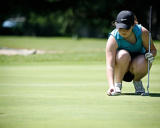Hannah Ogden places her ball during the Greatest Golfer junior qualifier on Thursday at Trumbull Country Club in Warren.