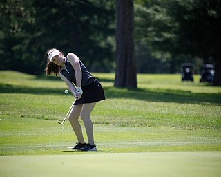 Marlie McConnell hits her ball during the Greatest Golfer junior qualifier on Thursday at Trumbull Country Club in Warren.