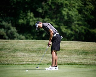 Jim Graham puts his ball during the Greatest Golfer junior qualifier on Thursday at Trumbull Country Club in Warren.
