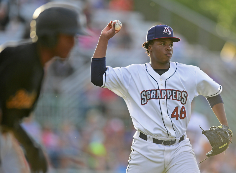NILES, OHIO - JUNE 15, 2018: Mahoning Valley Scrappers tarting pitcher Juan Mota looks to first before throwing out West Virginia Black Bears' Raul Siri in the third inning, Friday night at Eastwood Field. DAVID DERMER | THE VINDICATOR