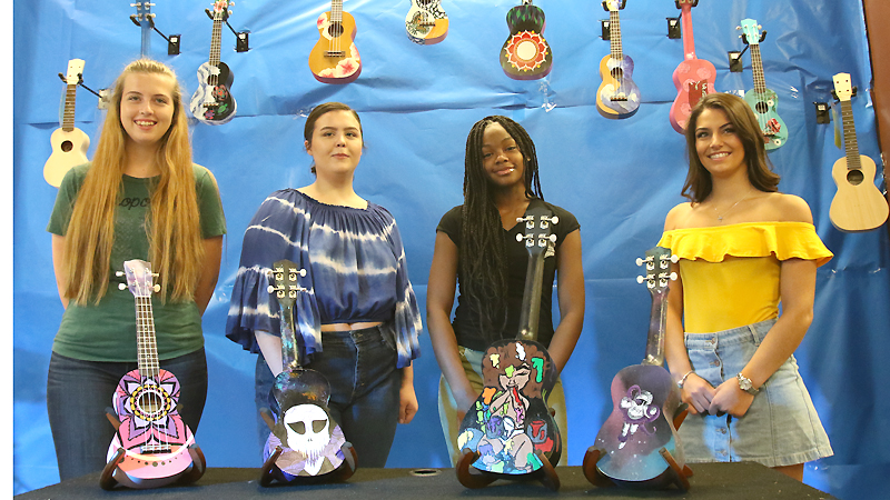 Hubbard Music Store in the Eastwood Mall is unveiling ukuleles that were hand painted by Lakeview, Hubbard and Liberty students Alissa Rodgers, from left, Hannah Best, Zion Jones and Taylor Begeot.