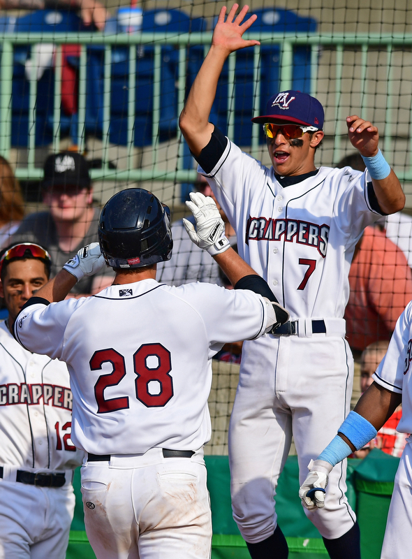 NILES, OHIO - JUNE 17, 2018: Mahoning Valley Scrappers' Simeon Lucas is welcomed back to the dugout by Tyler Freeman, right, after hitting a solo home run in the sixth inning of a baseball game against the West Virginia Black Bears, Sunday afternoon. The Scrappers won 10-9. DAVID DERMER | THE VINDICATOR