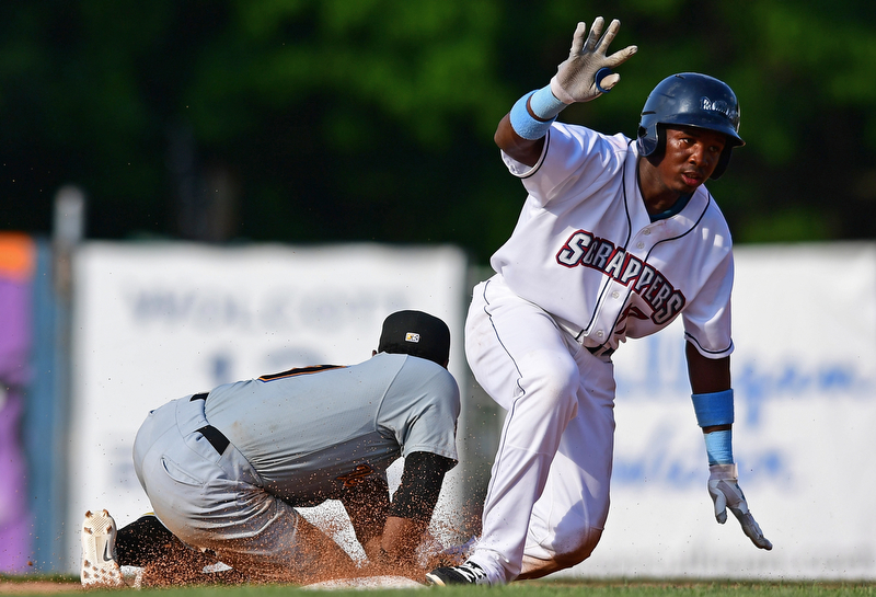 NILES, OHIO - JUNE 17, 2018: Mahoning Valley Scrappers' Miguel Eladio slides into second base for a double beating the tag from West Virginia Black Bears' Melvin Jimenez in the sixth inning of a baseball game, Sunday afternoon. The Scrappers won 10-9. DAVID DERMER | THE VINDICATOR
