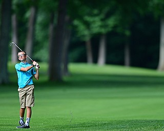 HOWLAND, OHIO - JUNE 19, 2018: Caleb Domitrovich of McDonald follows his approach shot on the sixth hole, Tuesday afternoon at Avalon Lakes during the Vindy Greatest Golfer qualifying tournament. DAVID DERMER | THE VINDICATOR