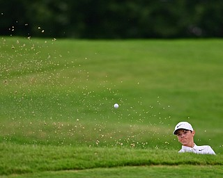 HOWLAND, OHIO - JUNE 19, 2018: Luke Eyster of Beaver Local follows his shot from a sand trap on the 18th hole, Tuesday afternoon at Avalon Lakes during the Vindy Greatest Golfer qualifying tournament. DAVID DERMER | THE VINDICATOR