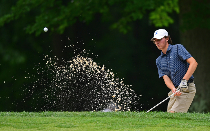 BOARDMAN, OHIO - JUNE 20, 2018: Jared DeVille, from Loveland, Ohio, follows his show from a sand trap on the 18th hole during the second round of the AJGA junior tournament, Wednesday afternoon at Mill Creek Golf Course. DAVID DERMER | THE VINDICATOR