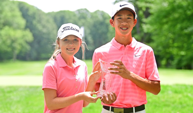 Sophie Linder, left, and Aidan Tran hold a Mahoning Valley Foundation Junior All-Star trophy on Thursday. Linder won the girls tournament by one stroke, while Tran was nine strokes ahead of the nearest golfer.