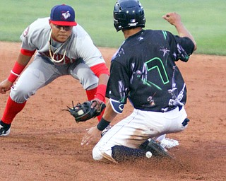 William D. Lewis The Vindicator  Scrappers Tyler Freeman(7) is out at 2nd as Auburn's Jose Sanchez(9) makes the tag during 6-22-18 action at Eastwood.