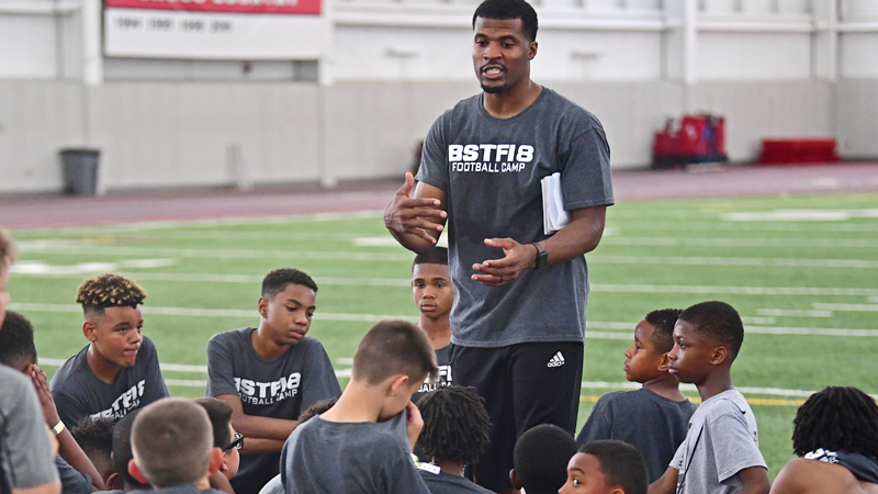Former NFL wide receiver Brad Smith speaks to the participants of his camp, Saturday morning at the WATTS indoor training facility at Youngstown State University.