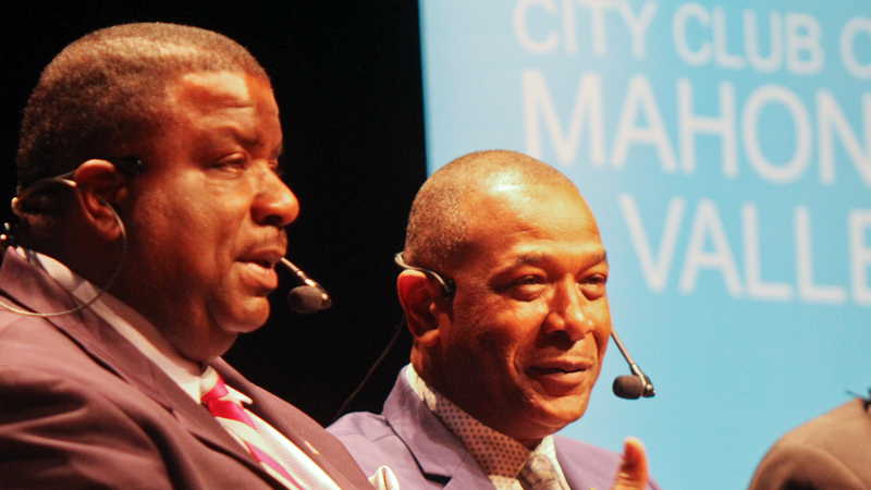 Youngstown Mayor Jamael Tito Brown, left, and Warren Mayor Doug Franklin participate in a City Club of the Mahoning Valley forum Monday at Packard Music Hall in Warren.