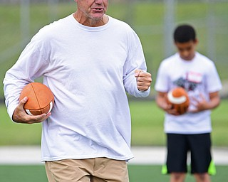 YOUNGSTOWN, OHIO - JUNE 25, 2018: Former NFL quarterback Mike Tomczak explains a technique to the quarterbacks during the Mooney football Camp of Champions, Monday morning at Cardinal Mooney High School. DAVID DERMER | THE VINDICATOR