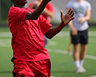 YOUNGSTOWN, OHIO - JUNE 25, 2018: Brandon Lee of Youngstown catches a pass during the Mooney football Camp of Champions, Monday morning at Cardinal Mooney High School. DAVID DERMER | THE VINDICATOR
