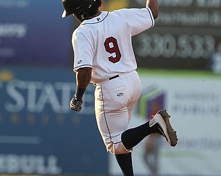 Scrappers catcher Jason Rodriguez thorws his arm in the air in celebration after hitting a solo home run in the bottom of the third inning during Monday evenings matchup against the Williamsport Crosscutters at Eastwood Field in Niles.