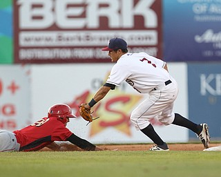 Scrappers second basemen Tyler Freeman (7) tags out Matt Vierling at second base for a double play after a line drive catch by Mahoning Valley's Elvis Perez in the top of the fifth inning during Monday evenings matchup against the Williamsport Crosscutters at Eastwood Field in Niles.