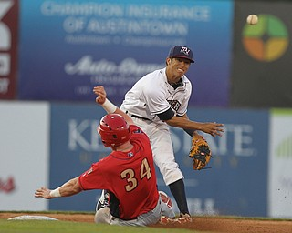 Scrappers second basemen Tyler Freeman (7) throws over Danny Mayer (34) of Williamsport to turn the double in the top of the sixth inning during Monday evenings matchup against the Williamsport Crosscutters at Eastwood Field in Niles.