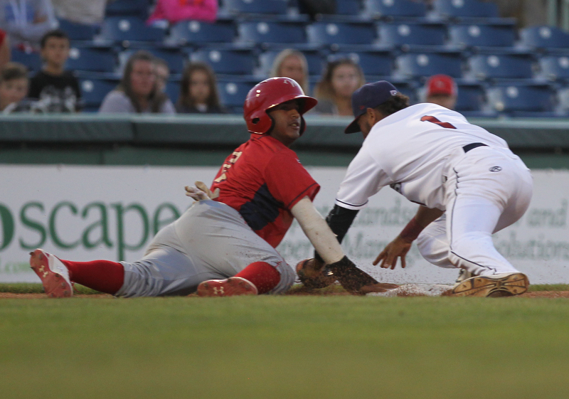 Elvis Perez (1) of the Scrappers dives back to third base to tag out Williamsport's Bryan Gonzalez (2) during Monday evenings matchup against the Williamsport Crosscutters at Eastwood Field in Niles.