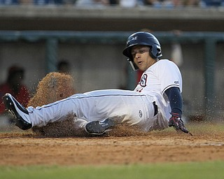 Tre Gantt (34) of the Scrappers slides safely into home in the bottom of the sixth inning during Monday evenings matchup against the Williamsport Crosscutters at Eastwood Field in Niles.