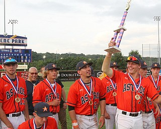 William D. Lewis The Vindicator  Astro Falcon's Craig Palidar(7) hoists the trophy after 6-26-18 win over Avalanche at Cene.