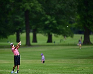 BOARDMAN, OHIO - JUNE 26, 2018: Jake Wilkeson of Canfield follows his approach shot on the ninth hole, Tuesday afternoon at Mill Creek Golf Course during the Vindy Greatest Golfer. DAVID DERMER | THE VINDICATOR