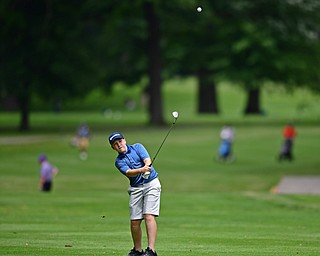 BOARDMAN, OHIO - JUNE 26, 2018: Ryan Sam of Boardman follows his approach shot on the ninth hole, Tuesday afternoon at Mill Creek Golf Course during the Vindy Greatest Golfer. DAVID DERMER | THE VINDICATOR