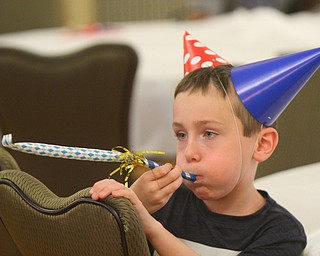 William D. Lewis The Vindicator  Bryce Lasher, 8, enjoys a party favor during Birthday Party for Youngstown at the Tyler History Center 6-27-18. He is a son of Brian/Melissa Lasher of Cortland.