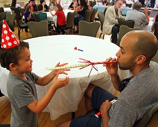 William D. Lewis The Vindicator   Flavio Aiken and his son Gio, 2, share a moment during Birthday Party for Youngstown at the Tyler Historuy Center 6-27-18.