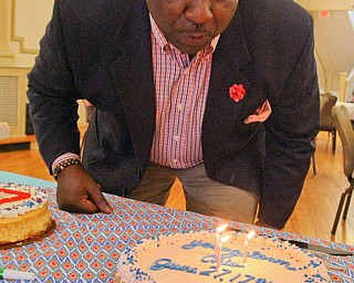 William D. Lewis The Vindicator   Youngstown Mayor Tito Brown blows out candles on a birthday cakeduring Birthday Party for Youngstown at the Tyler History Center 6-27-18.