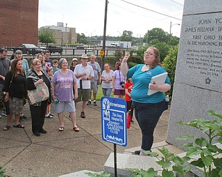 William D. Lewis The Vindicator  Traci Manning, curator of education at Tyler Mahoning Valley History Center, speaks to a gropup of people on a walking tour of downtown Youngstown as part of a birthday celebration for the city.