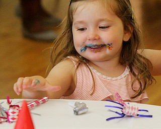 William D. Lewis The Vindicator   Youngstown Claire McNally, 2, reaches for a party favor after enjoying a cookieduring Birthday Party for Youngstown at the Tyler History Center 6-27-18. She is a daughter of 5th ward council member Lauren McNally.